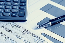 finance image of a pen and calculator