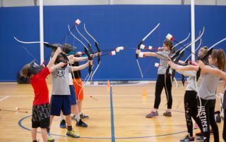 Children with safety archery bows and arrows